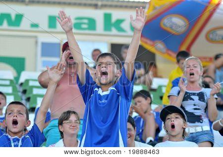 KAPOSVAR, HUNGARY - JULY 23: Romanian players celebrate after the VI. Youth Football Festival Under 11 Final FK Novi Grad (BOS) vs. Atletico Rosiori (ROM) July 23, 2010 in Kaposvar, Hungary