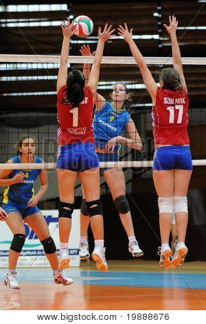 KAPOSVAR, HUNGARY - OCTOBER 3: Rebeka Rak (9) strikes the ball at the Hungarian NB I. League woman volleyball game Kaposvar vs Szolnok, October 3, 2010 in Kaposvar, Hungary.