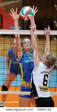 KAPOSVAR, HUNGARY - OCTOBER 10: Rebeka Rak (C) blocks the ball at the Hungarian NB I. League woman volleyball game Kaposvar vs Veszprem, October 10, 2010 in Kaposvar, Hungary.
