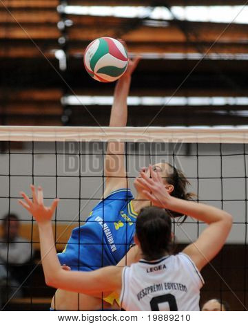 KAPOSVAR, HUNGARY - OCTOBER 10: Zsofia Harmath (in blue) in action at the Hungarian NB I. League woman volleyball game Kaposvar vs Veszprem, October 10, 2010 in Kaposvar, Hungary.