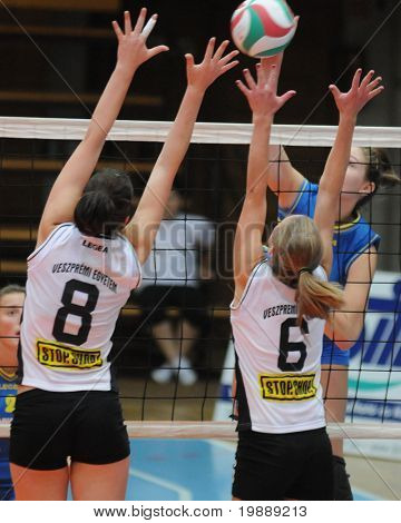 KAPOSVAR, HUNGARY - OCTOBER 10: Dora Kornyei (L) blocks the ball at the Hungarian NB I. League woman volleyball game Kaposvar vs Veszprem, October 10, 2010 in Kaposvar, Hungary.