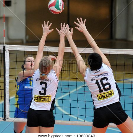 KAPOSVAR, HUNGARY - OCTOBER 10: Zsanett Pinter (L) in action at the Hungarian NB I. League woman volleyball game Kaposvar vs Veszprem, October 10, 2010 in Kaposvar, Hungary.