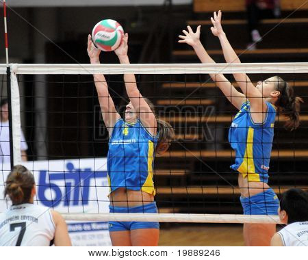 KAPOSVAR, HUNGARY - OCTOBER 10: Dora Ihasz (2nd from L) blocks the ball at the Hungarian NB I. League woman volleyball game Kaposvar vs Veszprem, October 10, 2010 in Kaposvar, Hungary.
