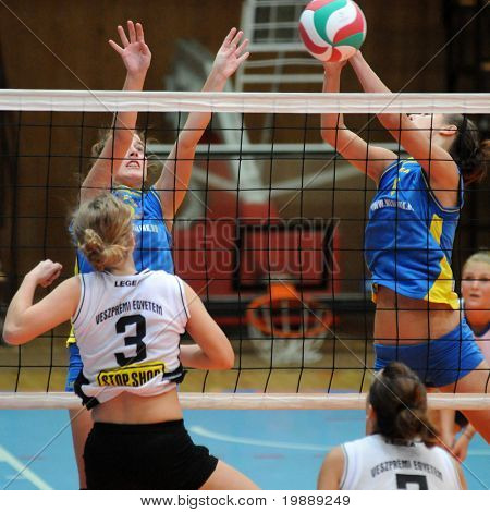 KAPOSVAR, HUNGARY - OCTOBER 10: Zsofia Harmath (L) blocks the ball at the Hungarian NB I. League woman volleyball game Kaposvar vs Veszprem, October 10, 2010 in Kaposvar, Hungary.
