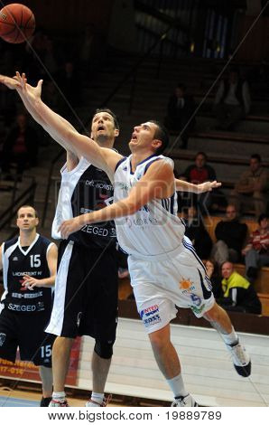 KAPOSVAR, HUNGARY - OCTOBER 24: Gabor Soos (R) in action at a Hugarian Champonship basketball game Kaposvar vs. Szeged October 24, 2010 in Kaposvar, Hungary.
