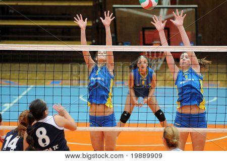 KAPOSVAR, HUNGARY - OCTOBER 31: Rebekra Rak (R) blocks the ball at the Hungarian NB I. League woman volleyball game Kaposvar vs Ujbuda, October 31, 2010 in Kaposvar, Hungary.