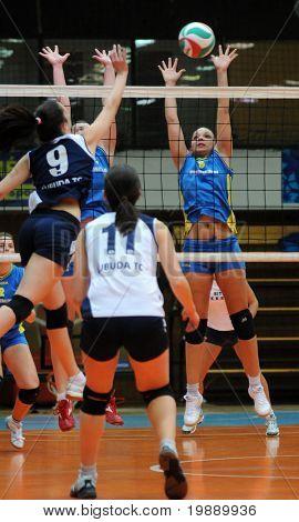 KAPOSVAR, HUNGARY - OCTOBER 31: Barbara Balajcza (8) blocks the ball at the Hungarian NB I. League woman volleyball game Kaposvar vs Ujbuda, October 31, 2010 in Kaposvar, Hungary.