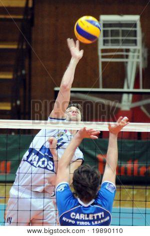 KAPOSVAR, HUNGARY - NOVEMBER 5: Krisztian Csoma (L) strikes the ball at a Middle European League volleyball game Kaposvar (HUN) vs Innsbruck (AUT), November 5, 2010 in Kaposvar, Hungary