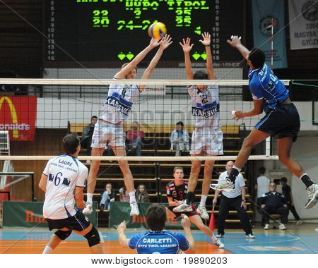KAPOSVAR, HUNGARY - NOVEMBER 5: Da Silva (R) strikes the ball at a Middle European League volleyball game Kaposvar (HUN) vs Innsbruck (AUT), November 5, 2010 in Kaposvar, Hungary