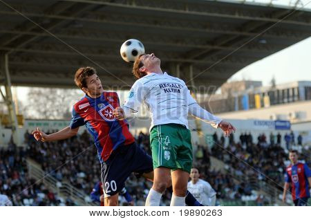 KAPOSVAR, HUNGARY - NOVEMBER 6: Pal Lazar (L) in action at a Hungarian National Championship soccer game Kaposvar vs Videoton FC November 6, 2010 in Kaposvar, Hungary.