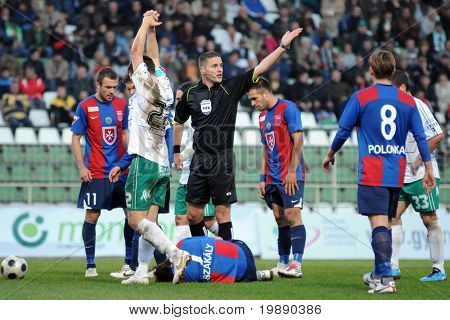 KAPOSVAR, HUNGARY - NOVEMBER 6: Sandor Ando-Szabo (FIFA referee) in action at a Hungarian National Championship soccer game Kaposvar vs Videoton November 6, 2010 in Kaposvar, Hungary.