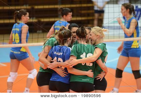 KAPOSVAR, HUNGARY - NOVEMBER 14: Miskolc players celebrate at the Hungarian NB I. League woman volleyball game Kaposvar vs Miskolc on November 14, 2010 in Kaposvar, Hungary.