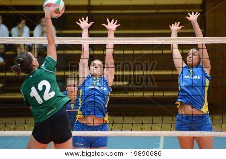KAPOSVAR, HUNGARY - NOVEMBER 14: Barbara Balajcza (R) blocks the ball at the Hungarian NB I. League woman volleyball game Kaposvar vs Miskolc on November 14, 2010 in Kaposvar, Hungary.