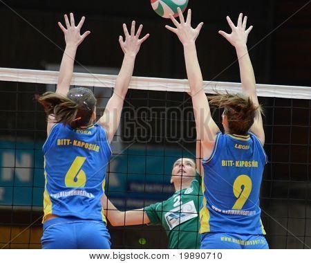 KAPOSVAR, HUNGARY - NOVEMBER 14: Rebeka Rak (R) blocks the ball at the Hungarian NB I. League woman volleyball game Kaposvar vs Miskolc on November 14, 2010 in Kaposvar, Hungary.