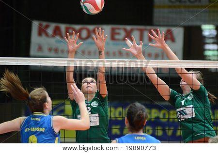 KAPOSVAR, HUNGARY - NOVEMBER 14: Rebeka Rak (L) in action at the Hungarian NB I. League woman volleyball game Kaposvar vs Miskolc on November 14, 2010 in Kaposvar, Hungary.
