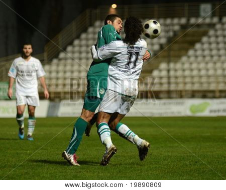 KAPOSVAR, HUNGARY - NOVEMBER 19: Jawad Daniane (R) in action at a Hungarian National Championship soccer game Kaposvar vs Gyori ETO November 19, 2010 in Kaposvar, Hungary.