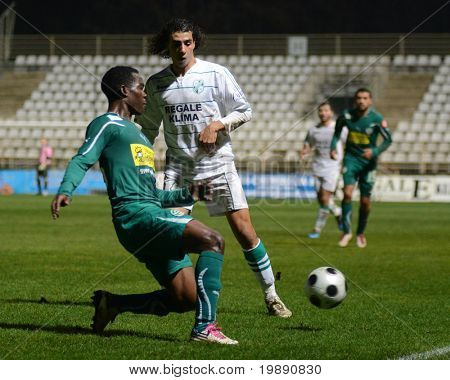 KAPOSVAR, HUNGARY - NOVEMBER 19: Jawad Daniane (2nd from L) in action at a Hungarian National Championship soccer game Kaposvar vs Gyori ETO November 19, 2010 in Kaposvar, Hungary.