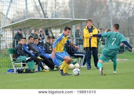 KAPOSVAR, HUNGARY - NOVEMBER 20: Patrik Bojte (R) in action at the Hungarian National Championship under 19 game between Kaposvari Rakoczi and Puskas Academy November 20, 2010 in Kaposvar, Hungary.