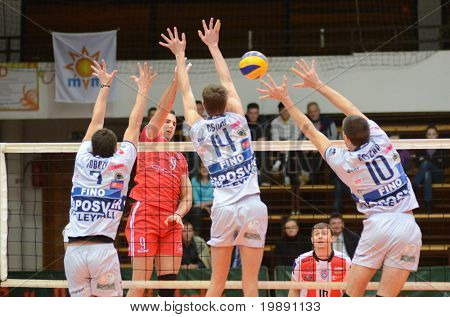 KAPOSVAR, HUNGARY - NOVEMBER 25: Krisztian Csoma (14) blocks the ball at the CEV Cup volleyball game Kaposvar (HUN) vs Resovia Rzeszov (POL), November 25, 2010 in Kaposvar, Hungary