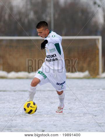 KAPOSVAR, HUNGARY - NOVEMBER 27: Patrik Bojte (7) in action at the Hungarian National Championship under 19 game between Kaposvar and Illes Academy November 27, 2010 in Kaposvar, Hungary.