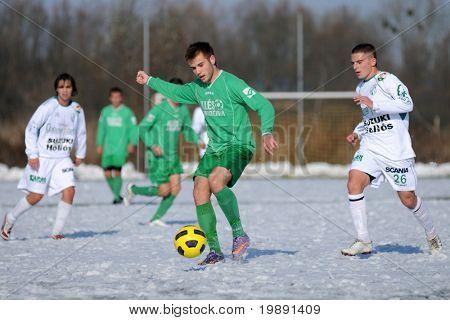 KAPOSVAR, HUNGARY - NOVEMBER 27: Krisztian Garai (R) in action at the Hungarian National Championship under 19 game between Kaposvar and Illes Academy November 27, 2010 in Kaposvar, Hungary.