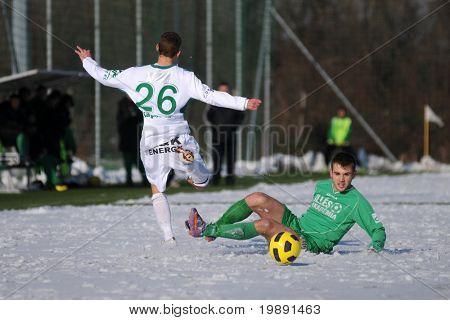 KAPOSVAR, HUNGARY - NOVEMBER 27: Krisztian Garai (L) in action at the Hungarian National Championship under 19 game between Kaposvar and Illes Academy November 27, 2010 in Kaposvar, Hungary.