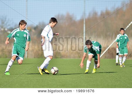 KAPOSVAR, HUNGARY - NOVEMBER 13: Unidentified players in action at the Hungarian National Championship under 15 game between Kaposvar and Gyori ETO November 13, 2010 in Kaposvar, Hungary.