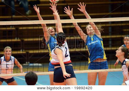KAPOSVAR, HUNGARY - DECEMBER 12: Rebeka Rak (9) blocks the ball at the Hungarian NB I. League woman volleyball game Kaposvar vs Eger on December 12, 2010 in Kaposvar, Hungary.