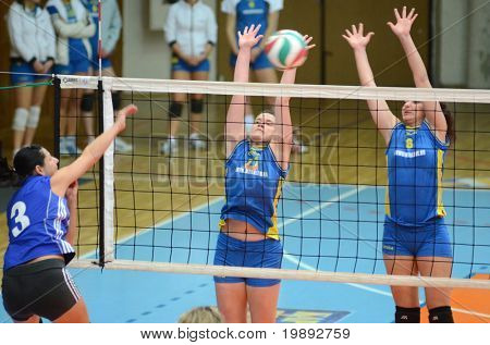 KAPOSVAR, HUNGARY - DECEMBER 19: Marianna Palfy (C) in action at the Hungarian NB I. League woman volleyball game Kaposvar vs Palota Bollhoff on December 19, 2010 in Kaposvar, Hungary.