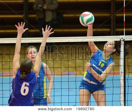 KAPOSVAR, HUNGARY - DECEMBER 19: Szandra Szombathelyi (R) in action at the Hungarian NB I. League woman volleyball game Kaposvar vs Palota Bollhoff on December 19, 2010 in Kaposvar, Hungary.
