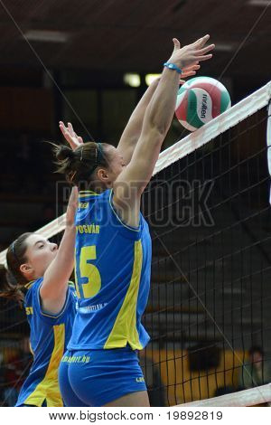 KAPOSVAR, HUNGARY - DECEMBER 19: Ajexandra Csaszar (L) blocks the ball at the Hungarian NB I. League woman volleyball game Kaposvar vs Palota Bollhoff on December 19, 2010 in Kaposvar, Hungary.