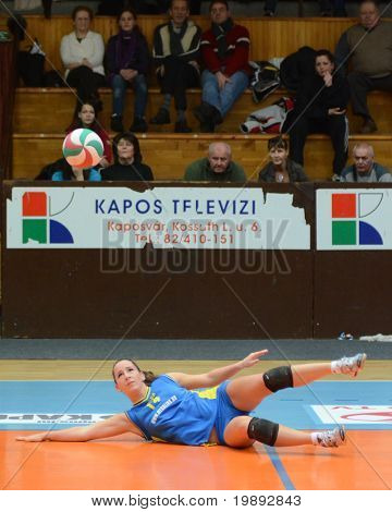 KAPOSVAR, HUNGARY - DECEMBER 19: Dora Ihasz receives the ball at the Hungarian NB I. League woman volleyball game Kaposvar vs Palota Bollhoff on December 19, 2010 in Kaposvar, Hungary.