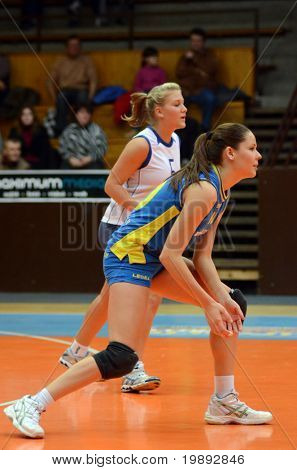 KAPOSVAR, HUNGARY - DECEMBER 19: Szandra Szombathelyi (in blue) in action at the Hungarian NB I. League woman volleyball game Kaposvar vs Palota Bollhoff on December 19, 2010 in Kaposvar, Hungary.