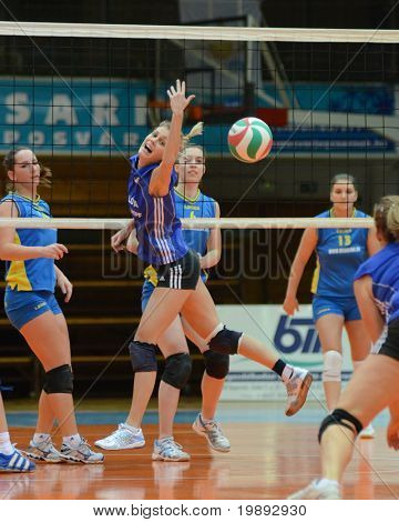 KAPOSVAR, HUNGARY - DECEMBER 19: Julia Karacsonyi (2nd from L) in action at the Hungarian NB I. League woman volleyball game Kaposvar vs Palota Bollhoff on December 19, 2010 in Kaposvar, Hungary.