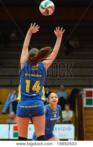 KAPOSVAR, HUNGARY - DECEMBER 19: Dora Ihasz (14) posts the ball at the Hungarian NB I. League woman volleyball game Kaposvar vs Palota Bollhoff on December 19, 2010 in Kaposvar, Hungary.