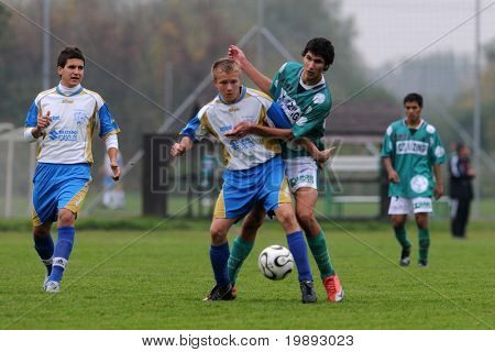 KAPOSVAR, HUNGARY - OCTOBER 16: Bence Kovacs (3rd from L) in action at the Hungarian National Championship under 17 game between Kaposvar and Kozarmisleny October 16, 2010 in Kaposvar, Hungary.