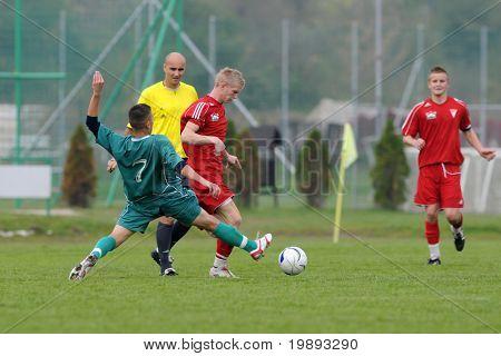 KAPOSVAR, HUNGARY - OCTOBER 16: Patrik Bojte (7) in action at the Hungarian National Championship under 19 game between Kaposvar and Debrecen October 16, 2010 in Kaposvar, Hungary.