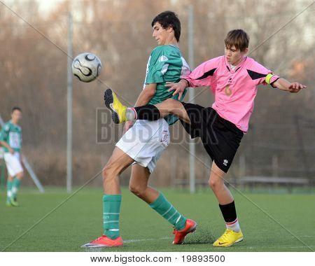 KAPOSVAR, HUNGARY - NOVEMBER 13: Bence Kovacs (in green) in action at the Hungarian National Championship under 17 game between Kaposvar and Szentlorinc November 13, 2010 in Kaposvar, Hungary.