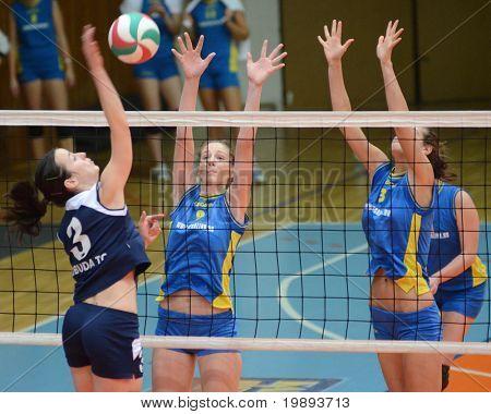 KAPOSVAR, HUNGARY - JANUARY 14: Rebeka Rak (9) blocks the ball at the Hungarian NB I. League woman volleyball game Kaposvar vs Ujbuda, January 14, 2011 in Kaposvar, Hungary.