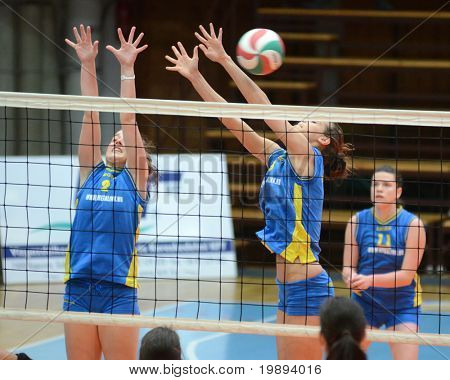 KAPOSVAR, HUNGARY - JANUARY 14: Zsofia Harmath (C) blocks the ball at the Hungarian NB I. League woman volleyball game Kaposvar vs Ujbuda, January 14, 2011 in Kaposvar, Hungary.