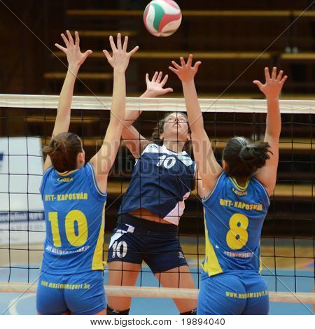 KAPOSVAR, HUNGARY - JANUARY 14: Szandra Szombathelyi (L) blocks the ball at the Hungarian NB I. League woman volleyball game Kaposvar vs Ujbuda, January 14, 2011 in Kaposvar, Hungary.