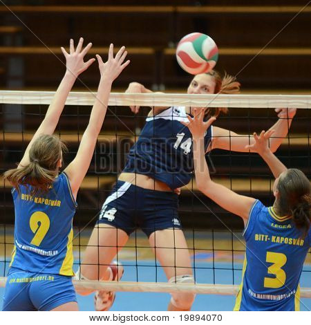 KAPOSVAR, HUNGARY - JANUARY 14: Rebeka Rak (L) blocks the ball at the Hungarian NB I. League woman volleyball game Kaposvar vs Ujbuda, January 14, 2011 in Kaposvar, Hungary.