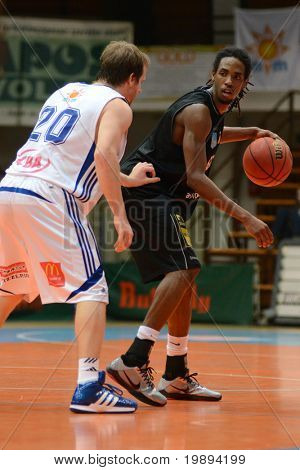 KAPOSVAR, HUNGARY - JANUARY 22: Bam Doyne (in black) in action at a Hungarian National Championship basketball game Kaposvar vs Szombathely January 22, 2011 in Kaposvar.