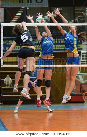 KAPOSVAR, HUNGARY - JANUARY 23: Marianna Palfy (C) blocks the ball at the Hungarian NB I. League woman volleyball game Kaposvar vs Miskolc, January 23, 2011 in Kaposvar, Hungary.