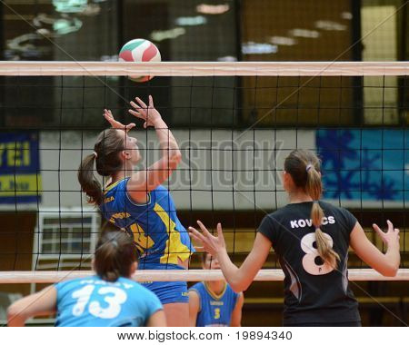 KAPOSVAR, HUNGARY - JANUARY 23: Dora Ihasz (C) in action at the Hungarian NB I. League woman volleyball game Kaposvar vs Miskolc, January 23, 2011 in Kaposvar, Hungary.