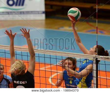 KAPOSVAR, HUNGARY - JANUARY 23: Szandra Szombathelyi (R) in action at the Hungarian NB I. League woman volleyball game Kaposvar vs Miskolc, January 23, 2011 in Kaposvar, Hungary.