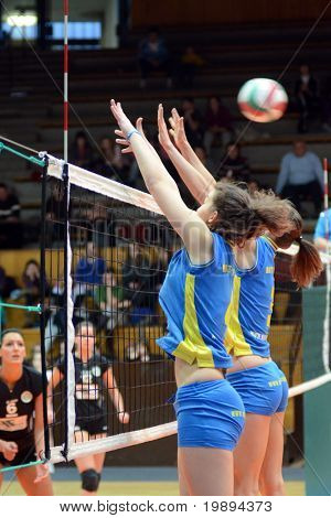 KAPOSVAR, HUNGARY - JANUARY 23: Petra Horvath (2nd from R) blocks the ball at the Hungarian NB I. League woman volleyball game Kaposvar vs Miskolc, January 23, 2011 in Kaposvar, Hungary.