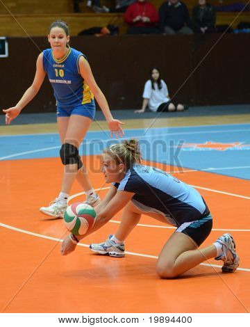KAPOSVAR, HUNGARY - JANUARY 23: Zsofia Horvath (5) receives the ball at the Hungarian NB I. League woman volleyball game Kaposvar vs Miskolc, January 23, 2011 in Kaposvar, Hungary.