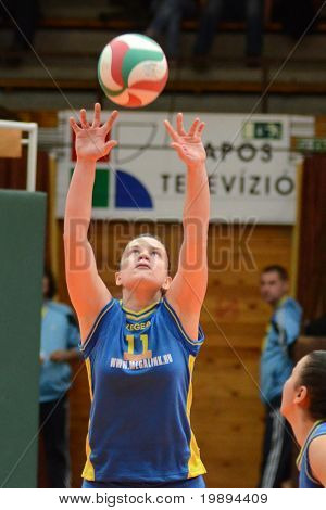 KAPOSVAR, HUNGARY - JANUARY 23: Dora Ihasz (14) in action at the Hungarian NB I. League woman volleyball game Kaposvar vs Miskolc, January 23, 2011 in Kaposvar, Hungary.