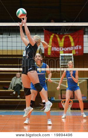 KAPOSVAR, HUNGARY - JANUARY 23: Unidentified player in action at the Hungarian NB I. League woman volleyball game Kaposvar vs Miskolc, January 23, 2011 in Kaposvar, Hungary.